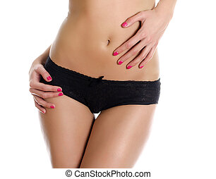 Belly and legs of beautiful woman in black panties. Isolated on white.