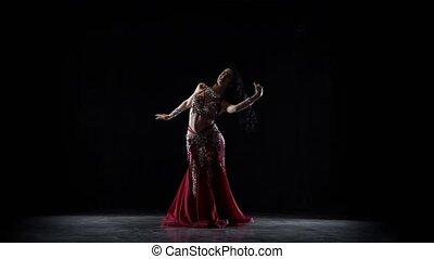 Belly dancer girl continue dance in chiffon dress . Black...