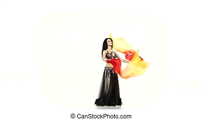 Belly dancer girl dance with long fans, wave her hair, shaking her hips, on white, slow motion