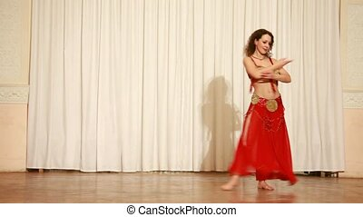 Belly dancer in red dress perform at stage - Brunette belly...