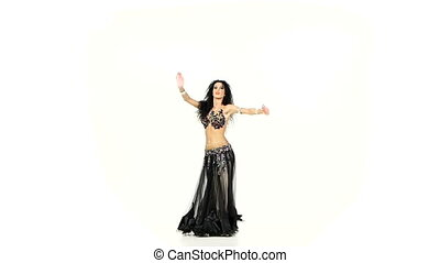 Belly dancer with dark hair dance and shaking her hips, on white, slow motion