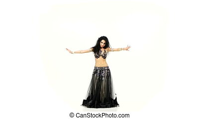 Belly dancer with dark hair dancing and shaking her hips, on white, slow motion