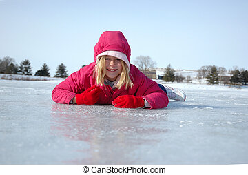 Belly Down on Ice 2 - Young girl prone on the ice during...