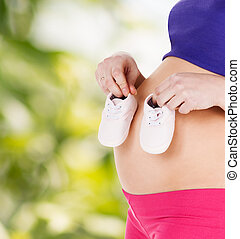 belly of a pregnant woman - pregnancy, maternity and health...