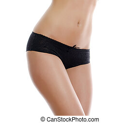 Belly of beautiful woman in black panties. Isolated on white.