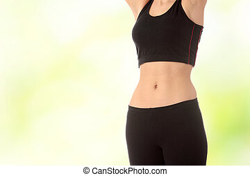Belly of beautiful young female sportsman