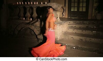 Bellydancer with candles in red dress.