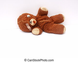 beloved old teddy bear, bandage over missing eye and no...