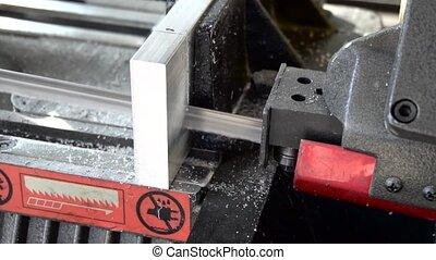 belt saw cutting metal slow motion