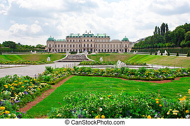 Belvedere Palace in a sunny day. Beautiful park with colorful flowers in the flowerbeds. Vienna. Austria