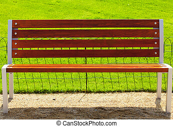 bench against a background of green grass