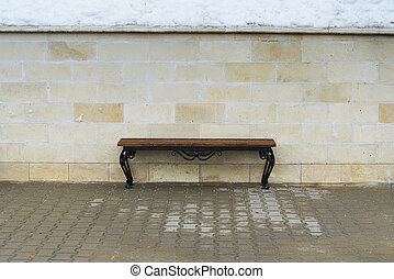 Bench against the wall.