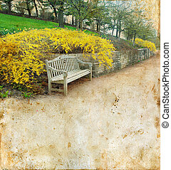 Bench and forsythia on a grunge background. Copy-space for your text.
