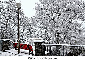 Bench and street lamp in the snow