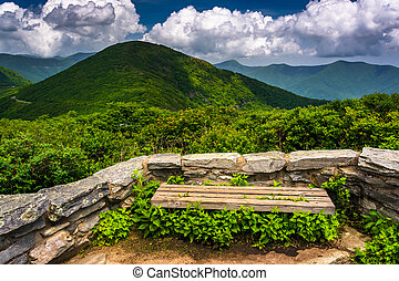Bench and view of the Appalachians from Craggy Pinnacle,...