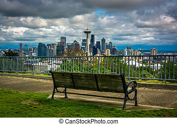 Bench and view of the downtown Seattle skyline, in Seattle, Washington.