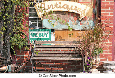 Bench at Antique Store - An old bench in front of an Antique...