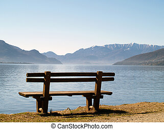bench at lake - A bench standing at a lake, overlooking...