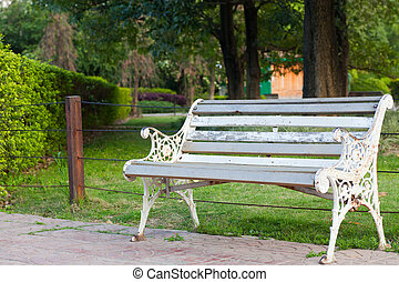 Bench by park in an arboretum