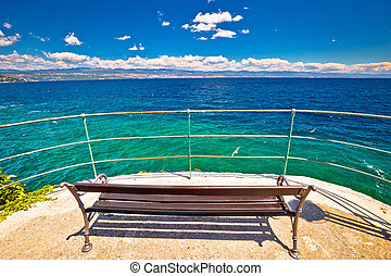 Bench by the sea on Lungomare walkway in Opatija riviera