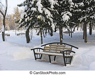 Bench for relaxation under the snow. Russia. Tomsk.