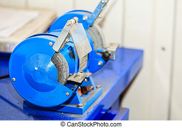 Bench grinder. - Blue bench grinder, electric tool in...