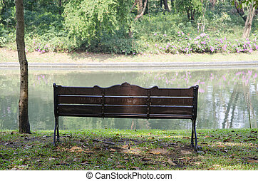 Bench in a park in spring time
