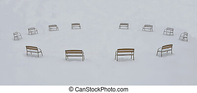 bench in a park in winter