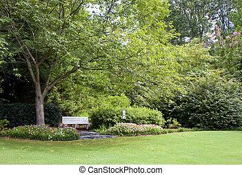Bench in Backyard Garden - A view of a beautifully...