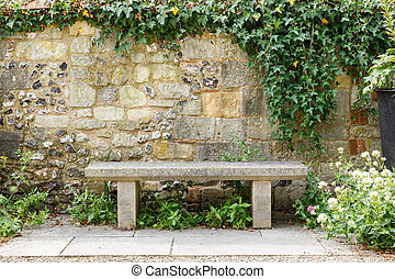 Bench in formal garden - Bench in a formal garden with an...