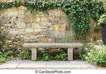 Bench in formal garden - Bench in a formal garden with an...