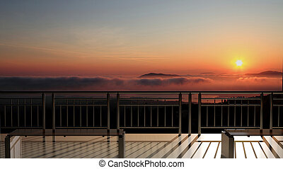 Bench in front of scenic view of beautiful sunset