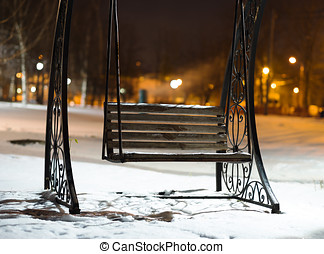 Bench in Moscow evening park background