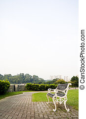 bench in park with copy space in sky