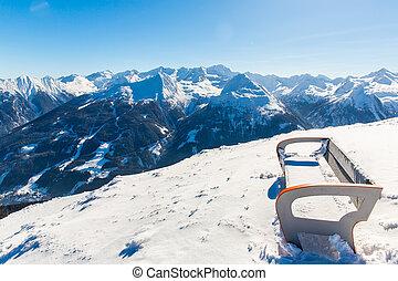 Bench in ski resort Bad Gastein in winter snowy mountains, Austria, Land Salzburg,  Austrian alps - nature and sport background