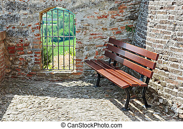 Bench in the courtyard of an old medieval fortress