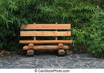 bench in the green bamboo park