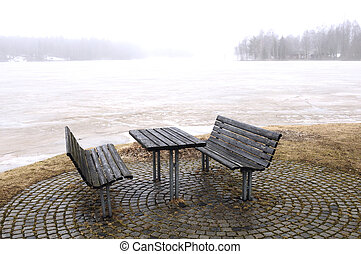 Bench in winter at the shore