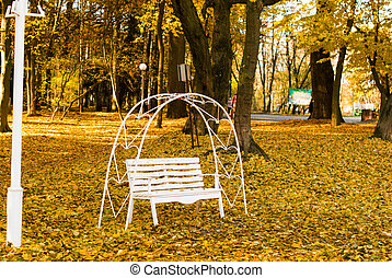 Bench of lovers in the autumn park