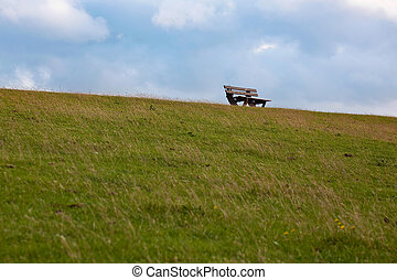 bench on a dike at the north sea - a bench on a dike at the...