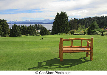 Bench on a green lawn in Bariloche, Argentina