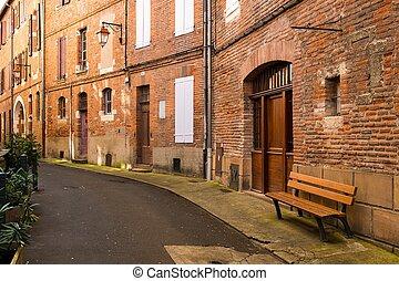 Bench on a narrow street in a european town