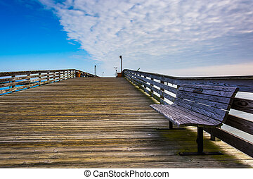 Bench on the pier in Chesapeake Beach, Maryland. - Bench on...