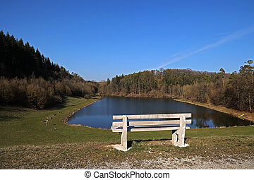 Bench on the shore of a beautiful lake