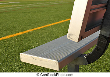 Bench on the Sideline of a Football Field - Empty Bench on...