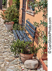 Bench on the street in the old town in Italy