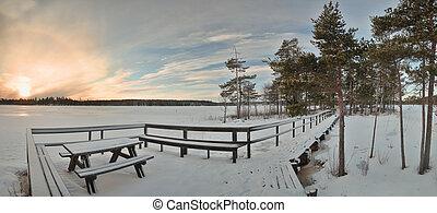 Bench, pier and island at lake Alebosjoen in Sweden