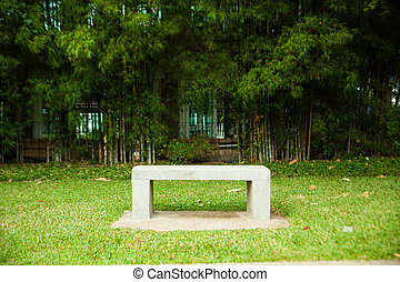 Bench seats and bamboo. Chair on the lawn green. Within the...