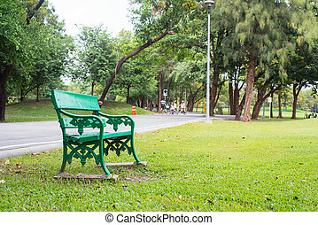 Bench under the tree beautiful colorful autumn park in sunny day.