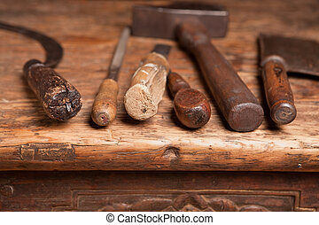 Wooden bench with rusty grungy tools and handles